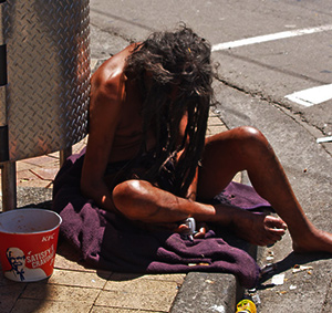 Homeless person on corner